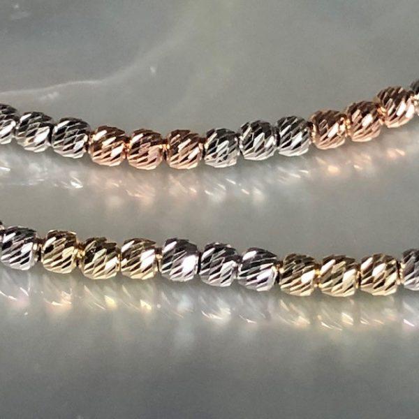 zwei bicolor Armbänder- weissgold und rotgold sowie Gelbgold und Weissgold aus facettierten Goldkügelchen 585