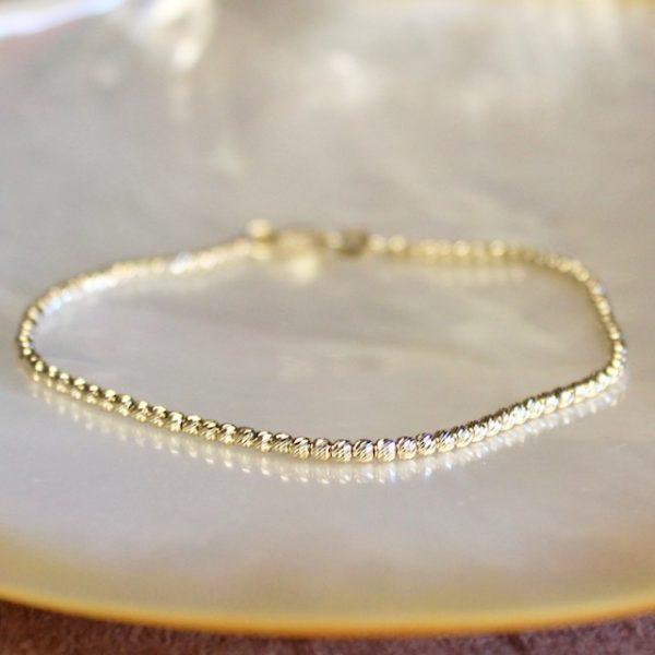 Feines Goldarmband aus facettierten Kügelchen, glitzernd aus 14k Gold mit Karabiner 18cm, in allen Lägen bestellbar